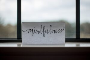 """A paper with the word """"mindfulness"""" written on it."""