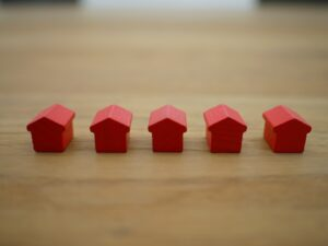A line of small red houses on a table.