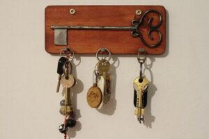 Different keys hanging on a wall.