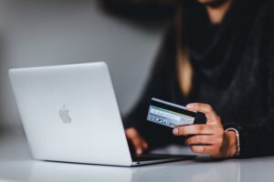 A woman using a credit card for online shopping.