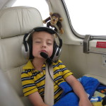 Wes Pak sleeping Roscoe plane