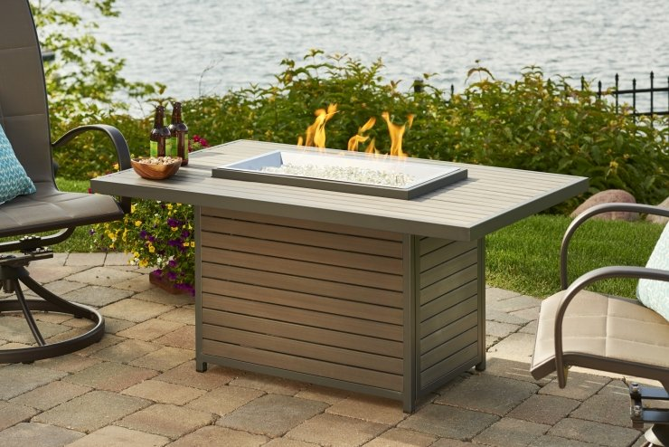 Enhance the comfort of your backyard with a fire pit or fire table