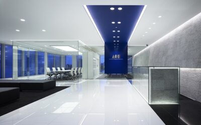 A modern office design that uses glass walls and partitions.