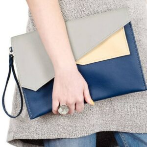 woman holding Good Mood Moon briefcase