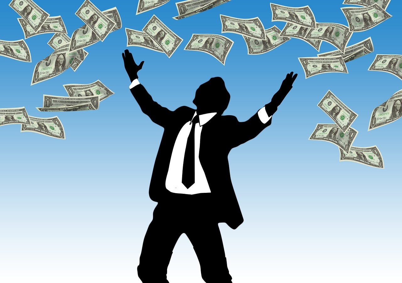 Man rejoicing over tons of money