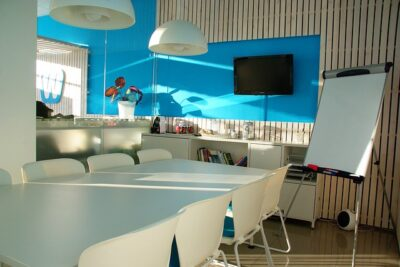 A small office space with blue color theme.