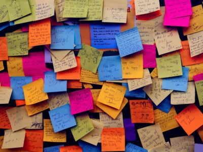 A bunch of sticky notes containing appreciation quotes for good work.