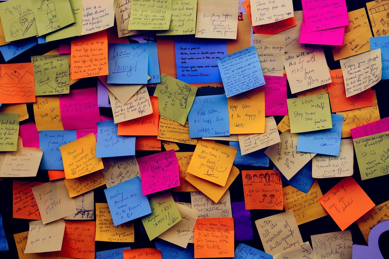 An example of a creative office notice board with colorful sticky notes.