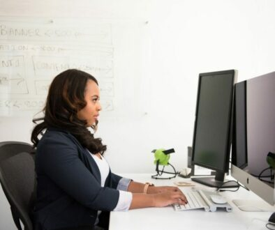 A woman working while sitting in an office chair that keeps on sinking.