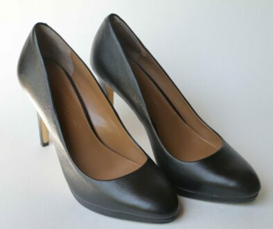 A pair of black, high-heeled shoes worn by most women at work.