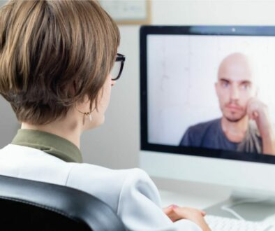 A woman having a meeting with her virtual team.
