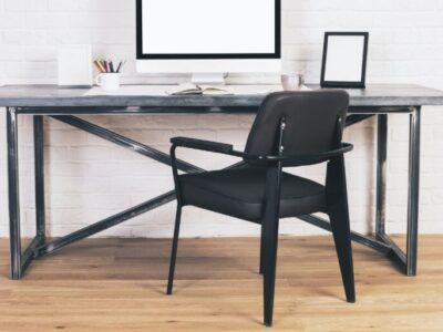 A desk chair no wheels.