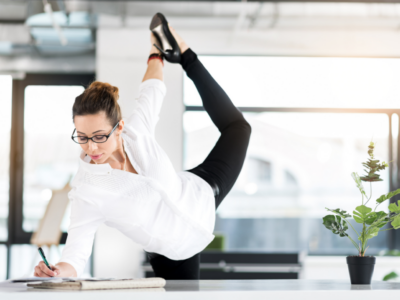 Woman doing standing exercise while working