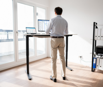 A tall man standing on his desk