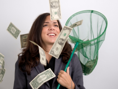 A picture of a woman trying to catch floating money in her wealthy imagination mindset to inspire her self