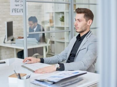 Young professional man working inside the office cubicle
