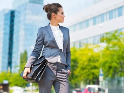 Beautiful middle aged woman holding her briefcase and wearing clean office attire