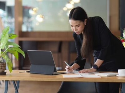 Young woman working on the desk table at the office