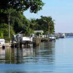 happy Naples, Florida canal living boating - naplesbonitamarco.com