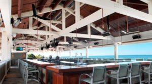 Outdoor bar at Mystique Pelican Bay. Photo: mystiquepelicanbay.com