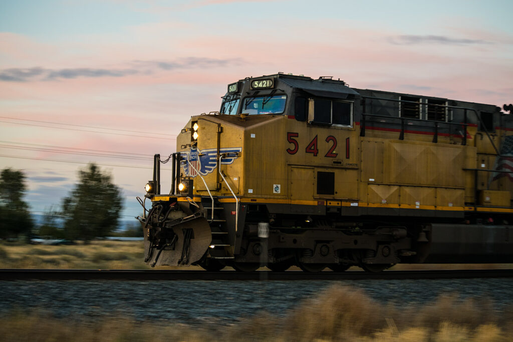 Pan shot of a moving locomotive in Bliss, Idaho.