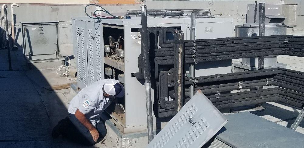 Man tracking down a refrigeration leak