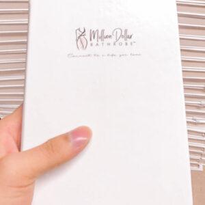 White Notebook with Million Dollar Bathrobe Logo on Cover