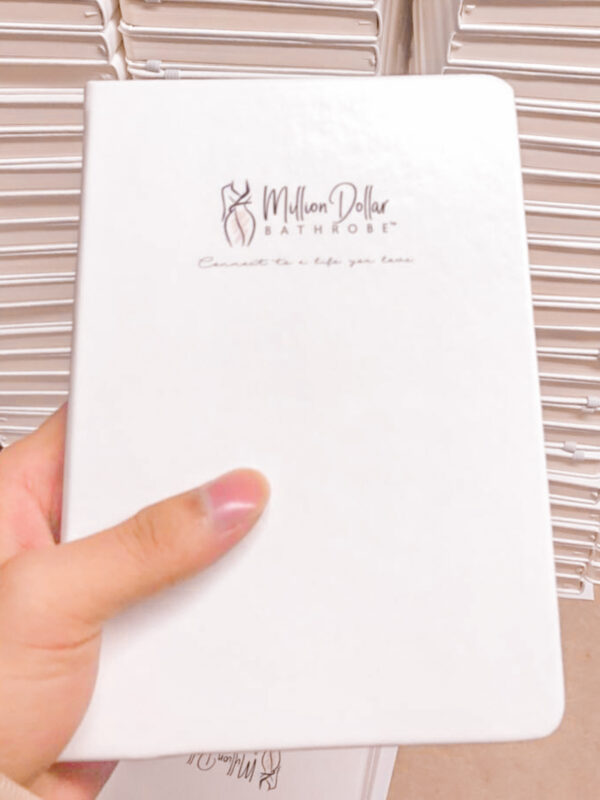 White Notebook with Million Dollar Bathrobe Logo on Cover