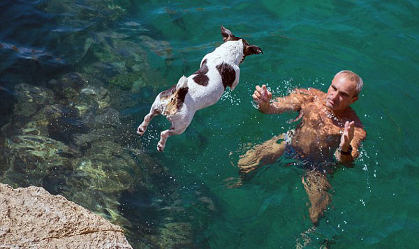 cliff diving dog and owner