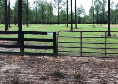 creosote fence with metal gate