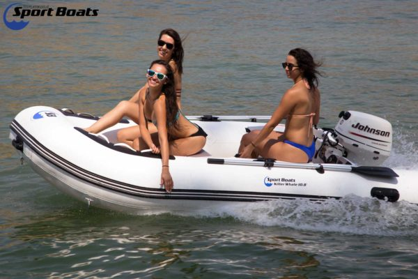 killer whale sport boat in action with girls