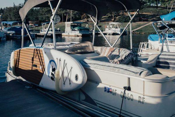 Sport board AIRBO 10.6' on pontoon boat holder