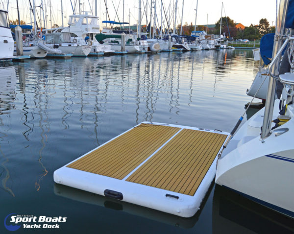 inflatable yacht dock behind yacht