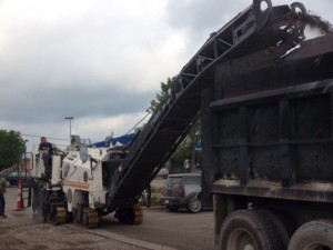 asphalt milling machine removing parking lot material