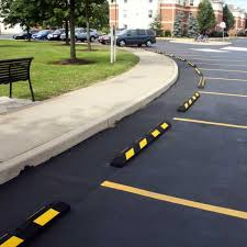 Recycled car stops installed in parking lot