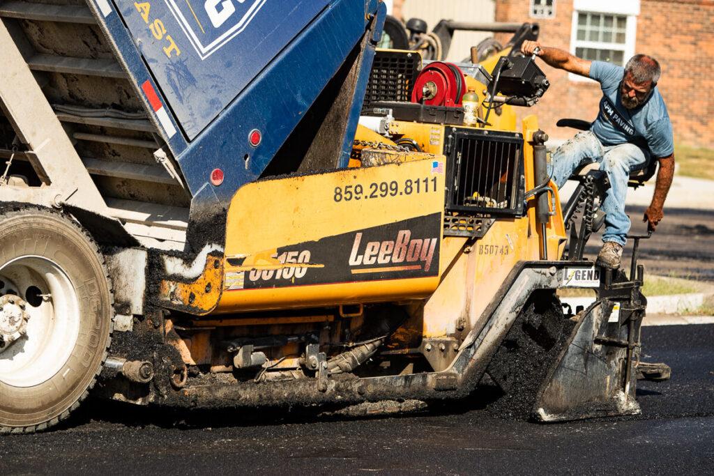 Asphalt for parking lot being installed using APM's asphalt paving machine