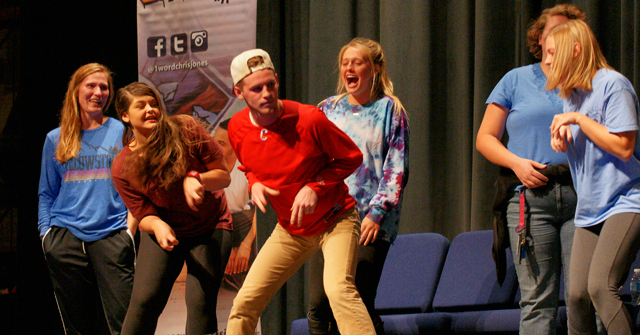 "Hypnotized students performing their ""Velociraptor dance"" on a show by Chris Jones"