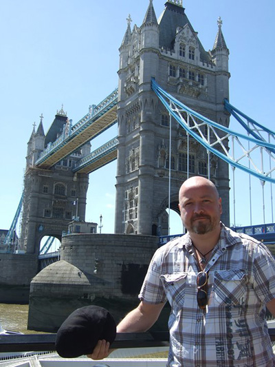 Westminster Associate Professor of History Dr. Mark Boulton stands at the Tower Bridge, London.