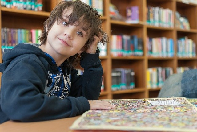 Child looking at book in the library