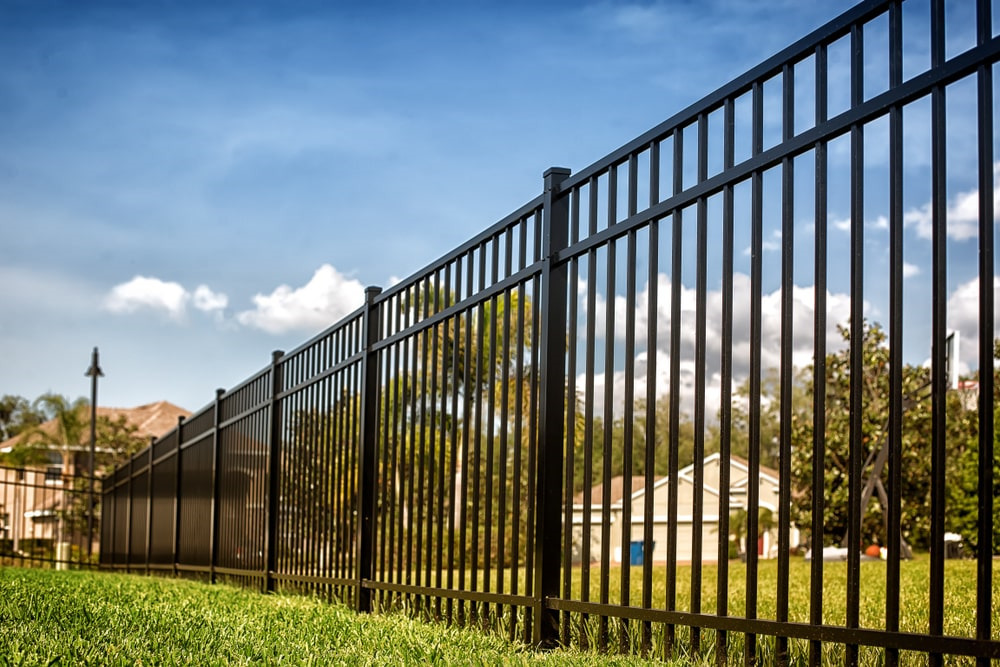 Sections-of-Black-Aluminum-Fence-on-a-property