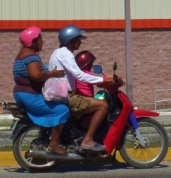 three people on moterbike