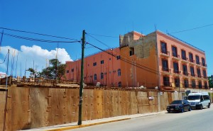 Hotel Playa Del Carmen on 20th Ave with new story added and construction next to it.