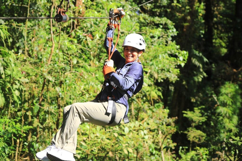 woman ziplining costa rica
