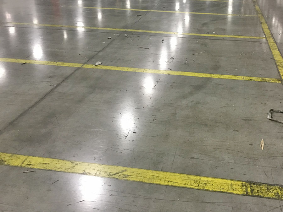 Warehouse floor lines prepped to be removed