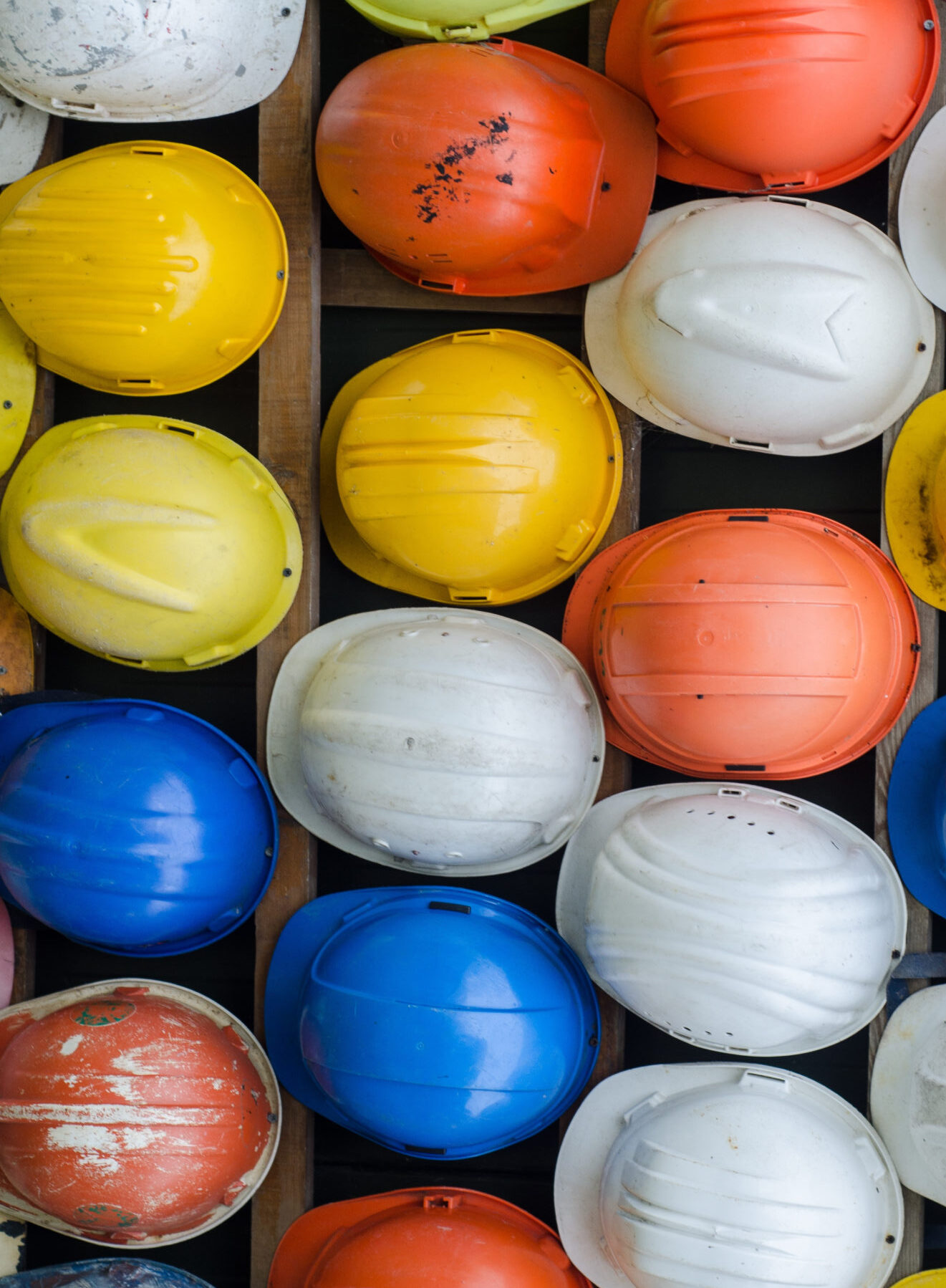 Canva - Colorful Construction Helmets