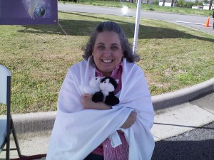 It started out rainy and very chilly. The kitties and I wrapped up in the tablecloth, but the sun came out soon.