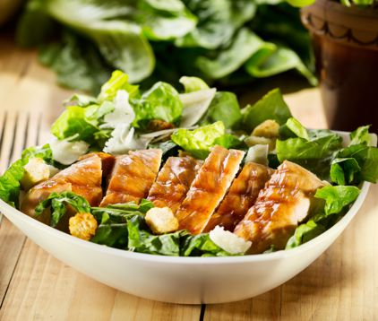 bowl of chicken salad on wooden table