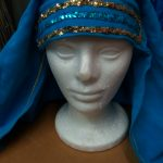 teal draped cloth headpiece