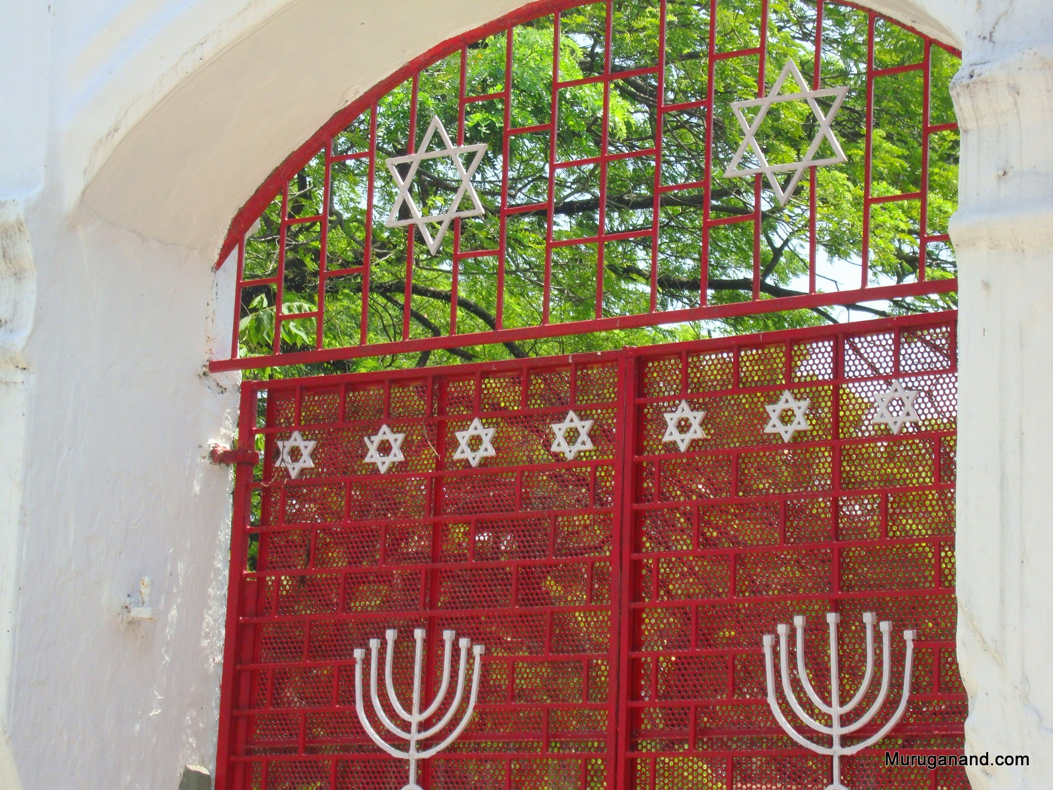A gate nearby with stars of David and Menorah