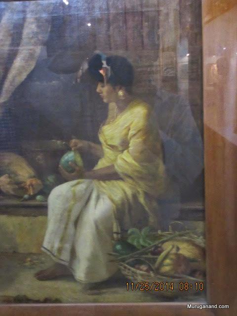 Mother preparing vegetables (1900)Raja Ravi Varma